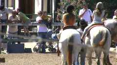 Young baby riding on the horse.  Stock Footage