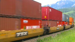 Stock Video Footage of railroad, freight train, container train on s-turn, #4 multi coloured containers
