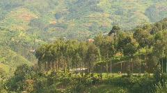 Minibus and minivan travel a steep mountain road in Rwanda. Stock Footage