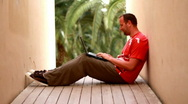 Man with laptop, outdoor Stock Footage