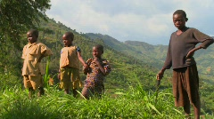 Rwanda children stand in farm fields. - stock footage