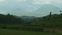 Establishing shot of the Virunga Volcanos on the Rwanda Congo border. - stock footage