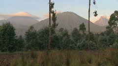 A wide shot of the Virunga volcano chain on the Rwanda Congo border. - stock footage