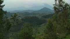The lush landscapes surrounding the Virunga volcanos on the Congo Rwanda border. - stock footage
