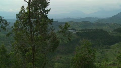 Slow pan across the lush landscapes surrounding the Virunga volcanos on the Stock Footage