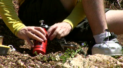 Pumping the camping stove.  Stock Footage