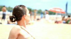 Woman on the beach taking sunbath  Stock Footage