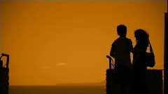 Young couple at sunset Stock Footage
