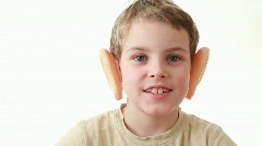 Boy with big ears turns his head Stock Footage