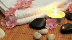 wellness time with candle, stones and blossoms - stock footage