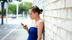 Attractive woman sending text message / sms Stock Footage