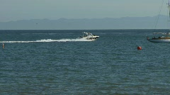 Sailboat and Speed Boat on Ocean 02 Stock Footage