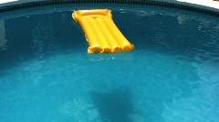 Sun bed floating in a pool Stock Footage