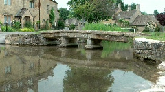 Old Bridge Across the River Eye in  Lower Slaughter Cotswolds - stock footage
