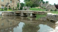 Stock Video Footage of Old Bridge Across the River Eye in  Lower Slaughter Cotswolds