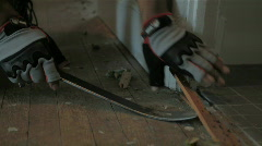Ripping up carpet - Gloves Stock Footage
