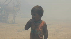 Little Boy in Front of Burning Rubbish Dump Stock Footage