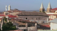 Stock Video Footage of A rooftop overview establishing shot of Stone Town, Zanzibar with mosques and