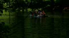 Kids jumping off boat in pond/lake into water in West, Virgina Stock Footage