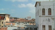 Stock Video Footage of Time lapse shot looking over the rooftops of Stone Town, Zanzibar.