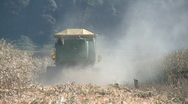Rear of dusty harvester Stock Footage