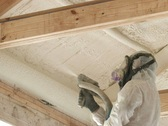 Technician spraying foam insulation into ceiling Stock Footage