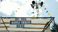 Buy Your Raffle Tickets here sign at Carnival Stock Footage