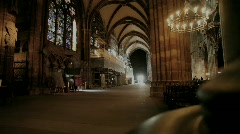 People walking in a gothic church Stock Footage