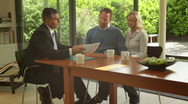 Wide, Track shot off couple signing contract at dinning table and handshake f Stock Footage