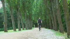 Cycling in Parkland Stock Footage