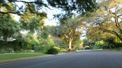 Leisure drive down tree lined streets Stock Footage