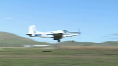 Cropduster liftoff from farm runway Stock Footage