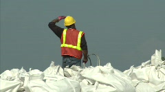 National Guard picks up sand bags to block BP Gulf of Mexico oil spill_04 Stock Footage