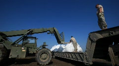National Guard picks up sand bags to block BP Gulf of Mexico oil spill_16 Stock Footage