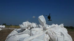 National Guard picks up sand bags to block BP Gulf of Mexico oil spill_21 Stock Footage
