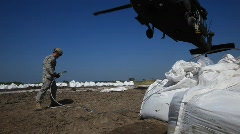 National Guard picks up sand bags to block BP Gulf of Mexico oil spill_22 Stock Footage