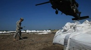 Stock Video Footage of National Guard picks up sand bags to block BP Gulf of Mexico oil spill_22