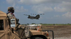 National Guard picks up sand bags to block BP Gulf of Mexico oil spill_32 Stock Footage