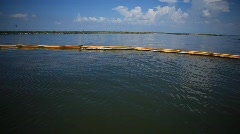 Oiled booms protect Pelican Island from the BP Gulf oil spill_05 Stock Footage