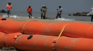 BP workers clean oiled beach after Gulf of Mexico oil spill_01 Stock Footage