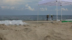 BP workers clean oiled beach after Gulf of Mexico oil spill_04 - stock footage