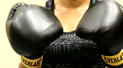 Sweaty Female Boxer Punches Camera Stock Footage
