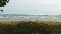 wide shot of waves rolling in on windy day - stock footage