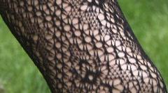 tilt up on plastic leg on green background - stock footage