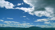 Stock Video Footage of Clouds over the mountain