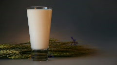 Glass Of Milk With Cornflower, Wheat And Rolling Nuts Stock Footage