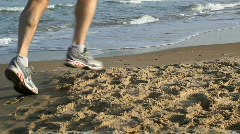 Mediterranean sea. Running on the beach. Crocs shoes Stock Footage