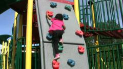 Little Asian Girl On A Climbing Wall Stock Footage