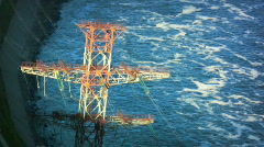 High voltage electric pole on the river Stock Footage