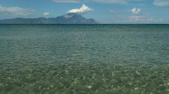 Beach foreshore with transparent water and landscape Stock Footage